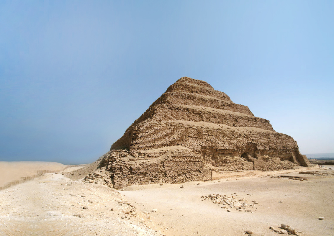 A weathered and slightly crumbling stepped pyramid in the desert, Egypt