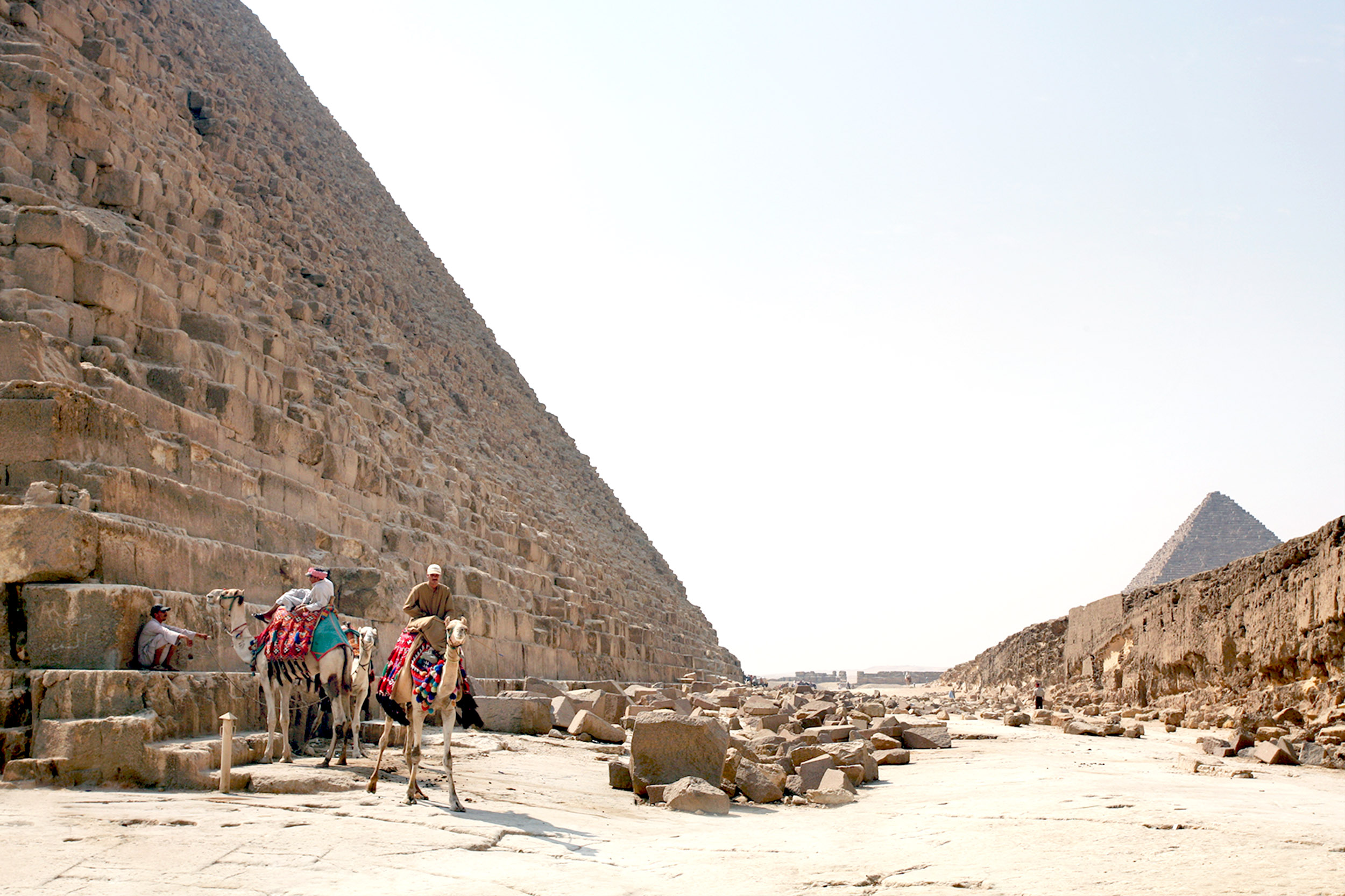 Great Pyramid of Giza (or Khufu) with a couple of camels and riders at its base, Egypt