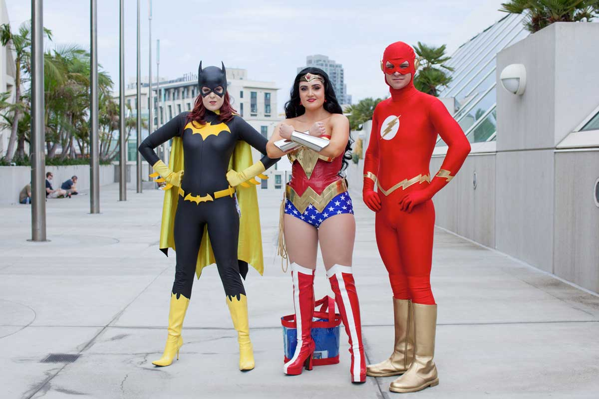 Trio dressed as comic book characters at Comic-Con, San Diego