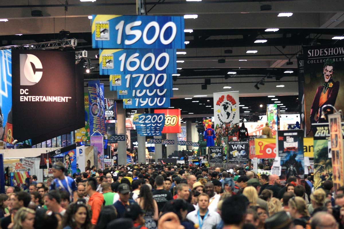 Crowd thronging in the Comic-Con hall banners and posters above their heads, San Diego