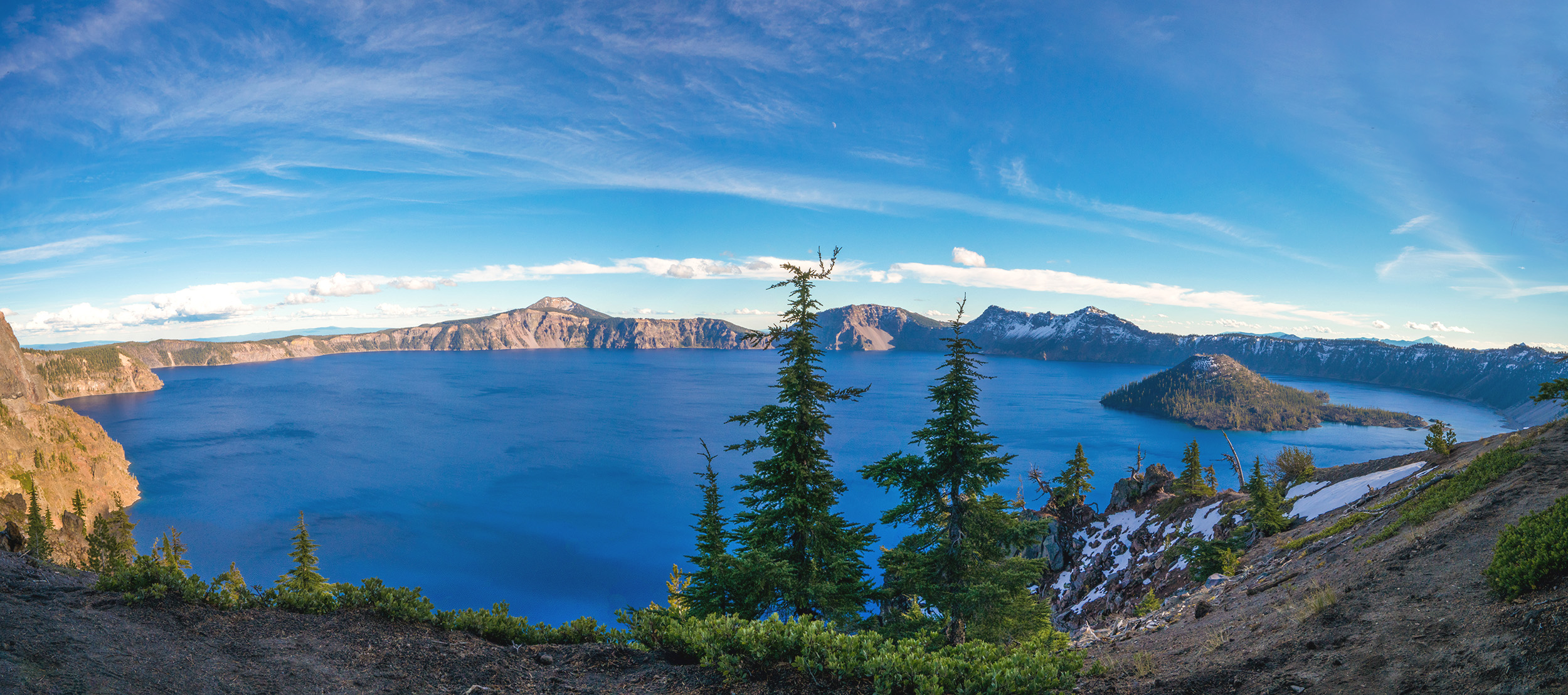 Landscape view from a hill of the vast expanse of Crater Lake, Oregon