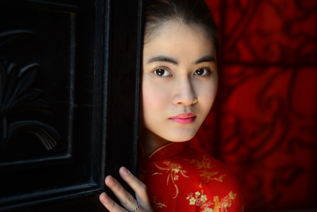 Portrait of a lady in red in Saigon.