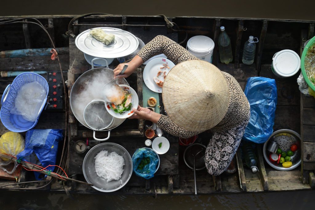 Vietnamese style cooking on a boat on the Mekong Delta, southern Vietnam.