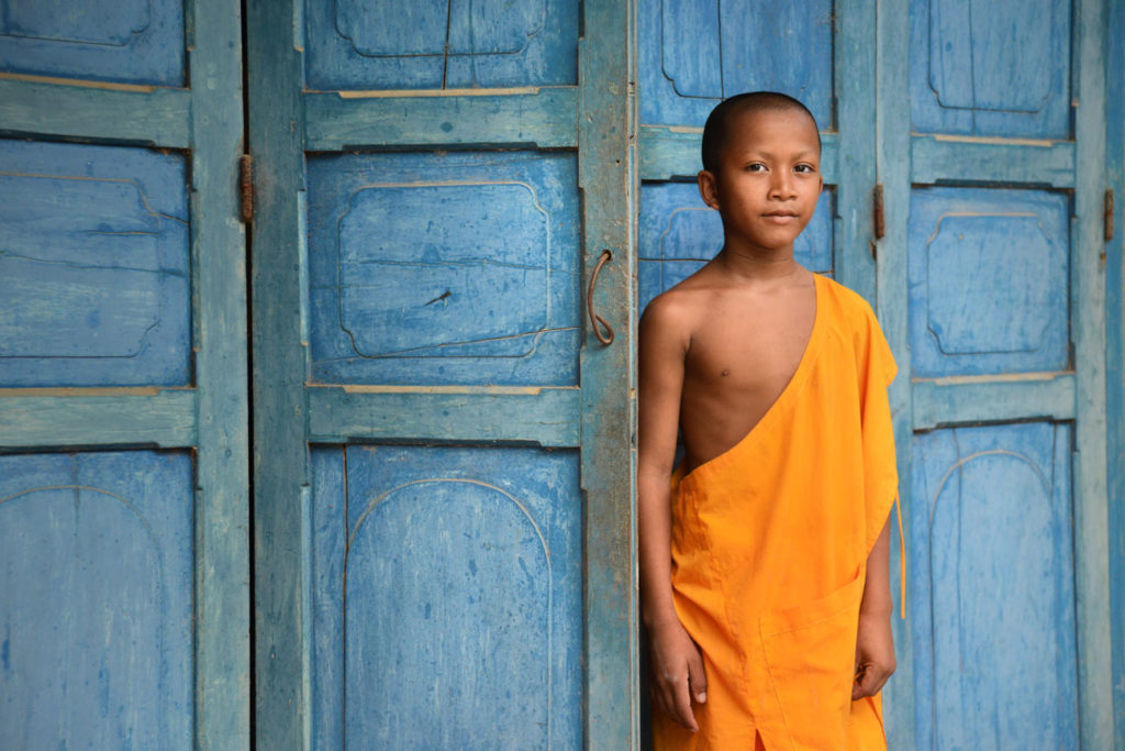 Portrait of a novice monk at a Khmer monastery in the South of Vietnam, near the Cambodian border.