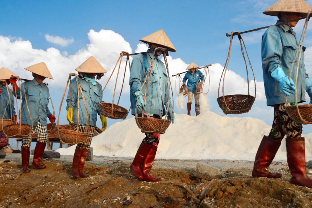 Salt harvesters of Hon Khoi. These ladies normally start work at 3 or 4am, finishing by 9am.