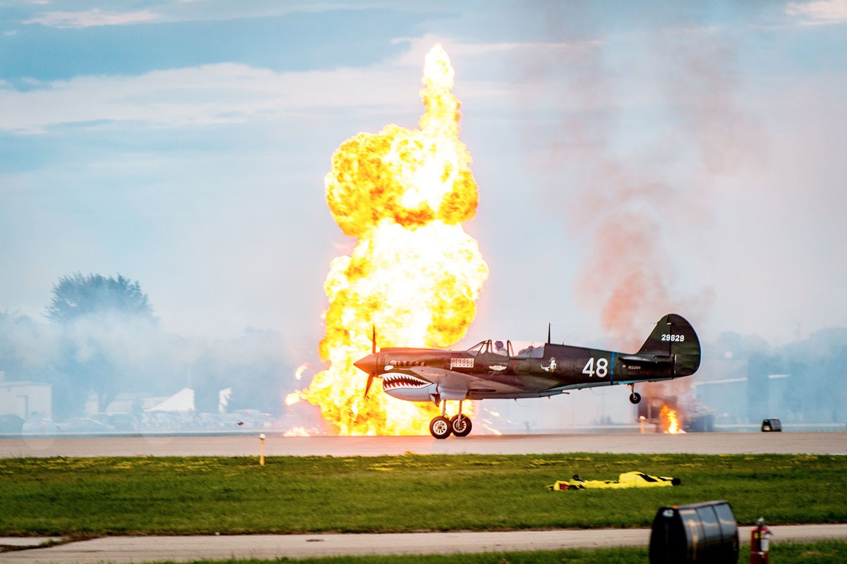 A fireball by one of the planes on the tarmac at EAA AirVenture