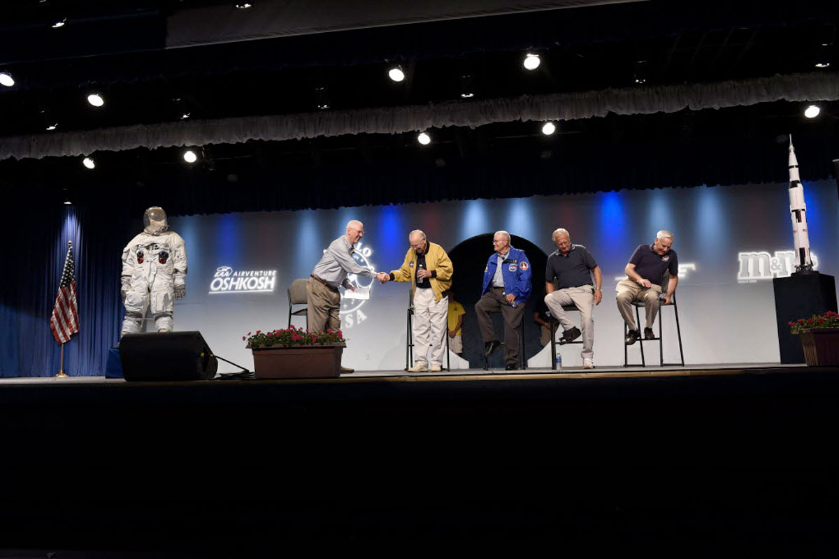 Performers on a stage at EAA Oshkosh