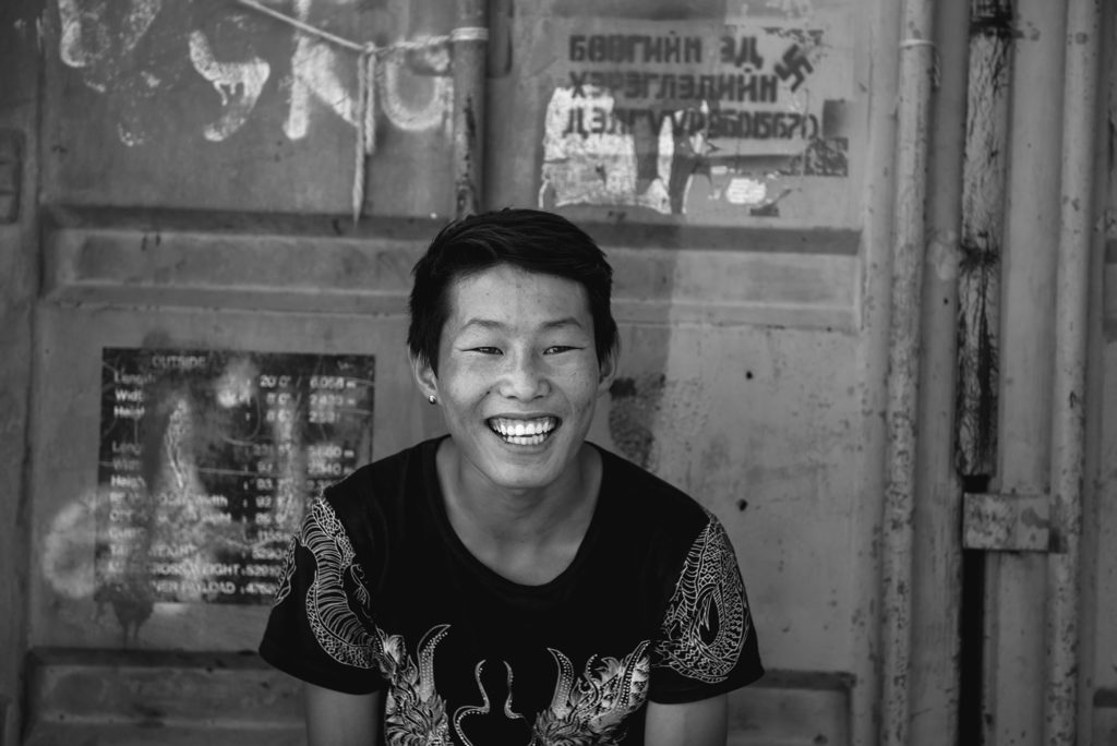 A boy selling clothes at a market in Ulaanbaatar.