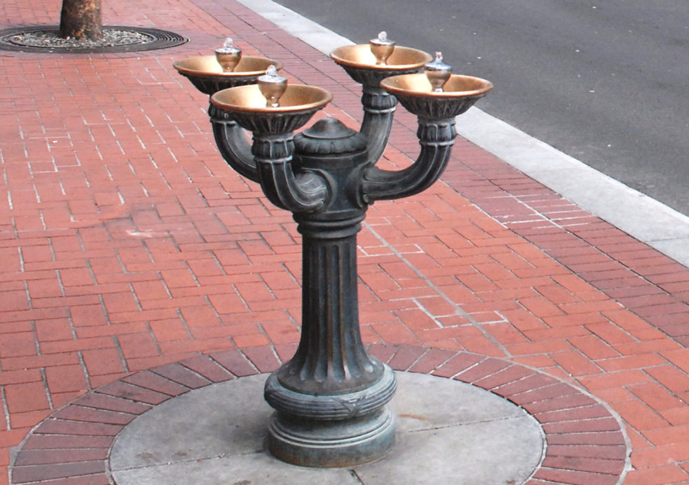 A four armed Benson Bubbler metal fountain in central Portland