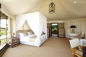 Draped four-poster bed in a luxury tent cabin in Queensland, Australia