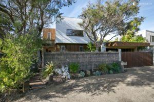 Large luxury villa set behind trees in Victoria, Australia