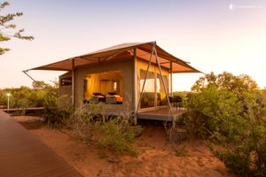 Sunset over one of a group of beachfront tented cabins