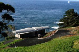 Clifftop house next to a dark blue sea in Devonport, Tasmania