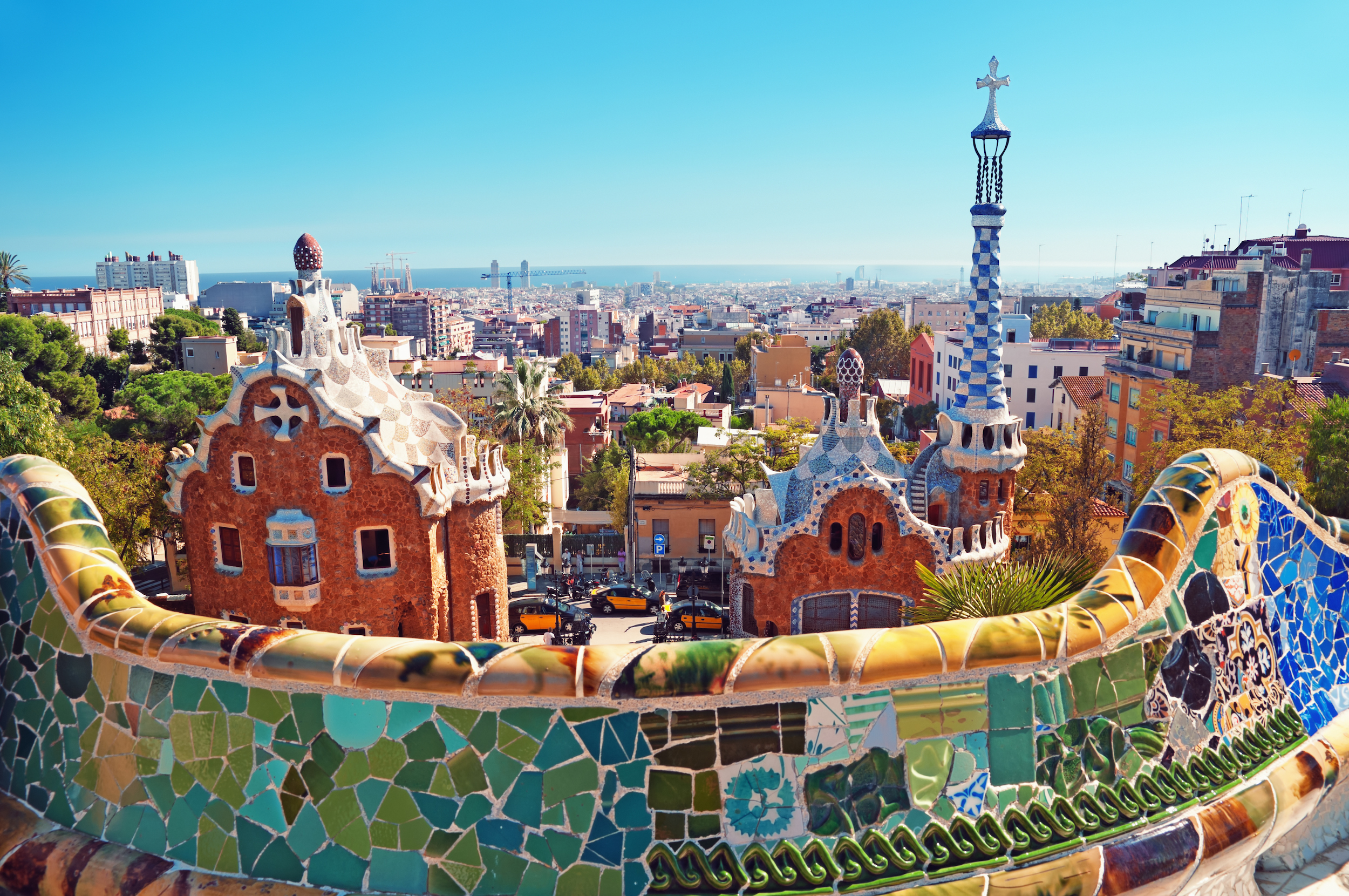 From from a multicoloured, tiled balcony overlooking the city of Barcelona