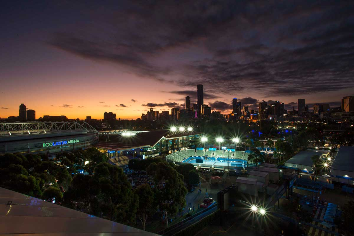 Aerial night view of the Rod Laver Arena, Garden Square and the Melbourne skyline in the background