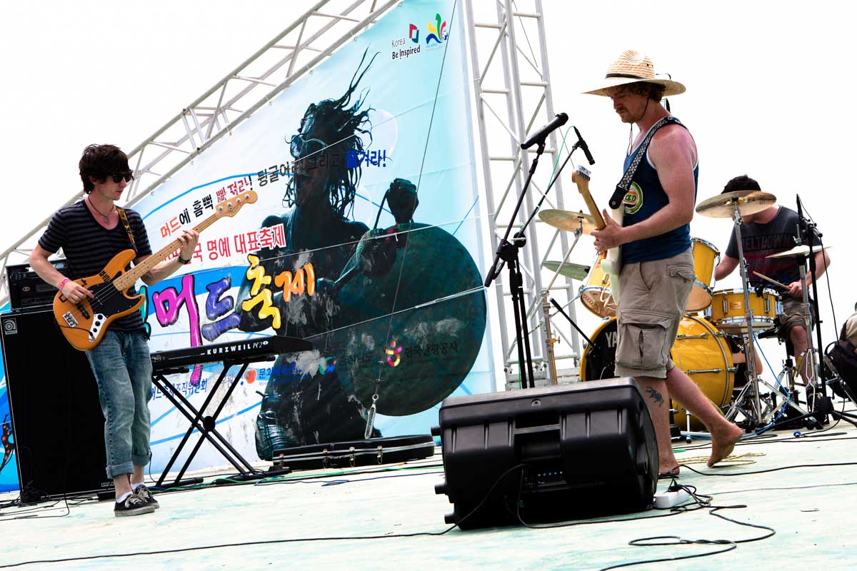 Trio performing on stage at Boryeoung Mud Festival