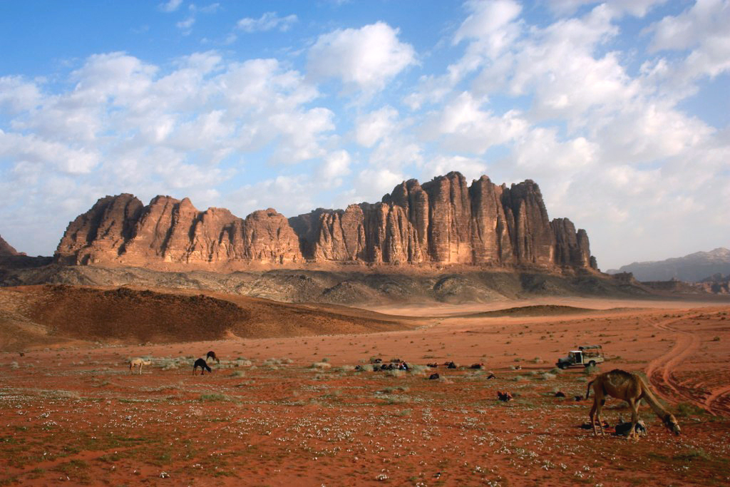 A distant view of the isolated rock formations of Wadi Rum.