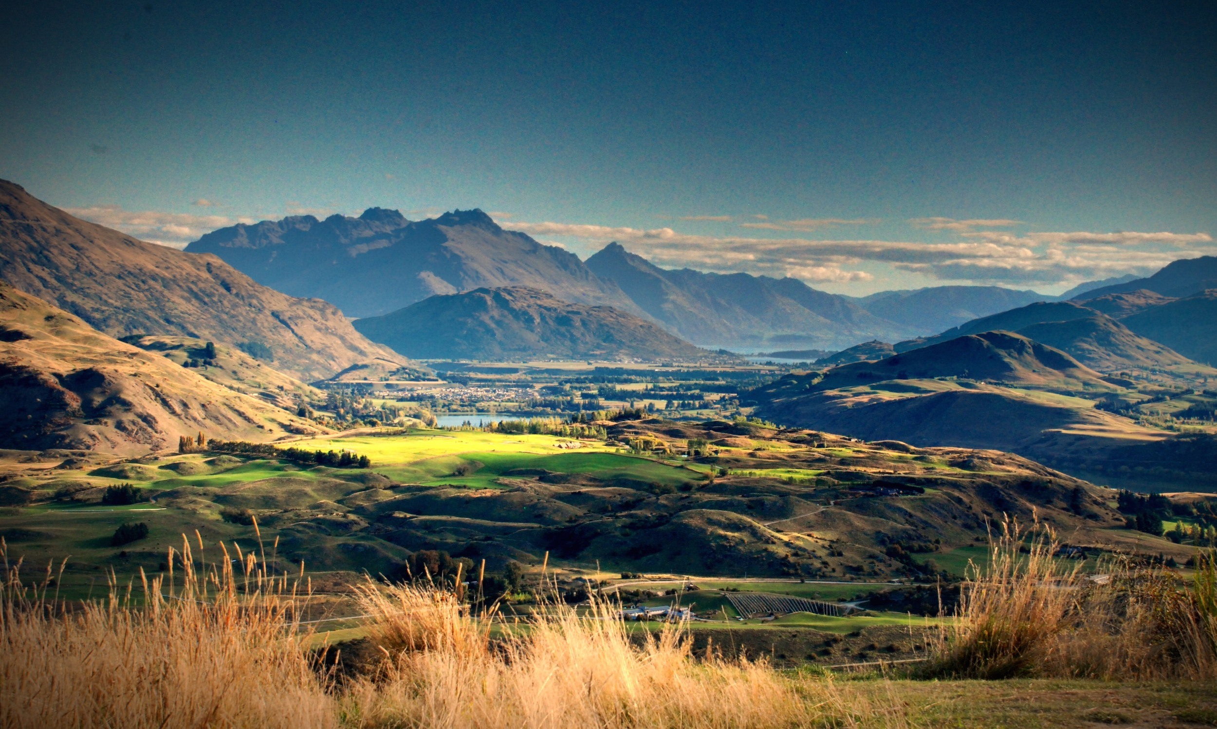 Hills and brown-coloured mountains surround the small historic Arrowtown
