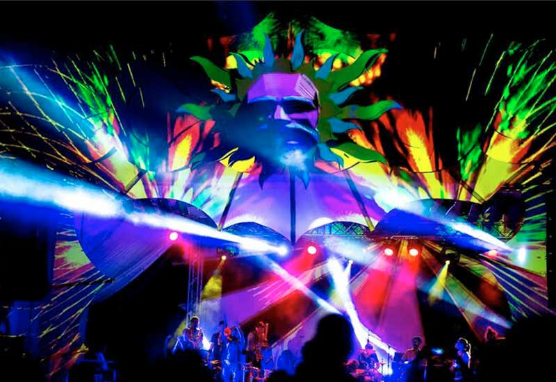 A spectacular light show around the stage at night at the Envision Festival