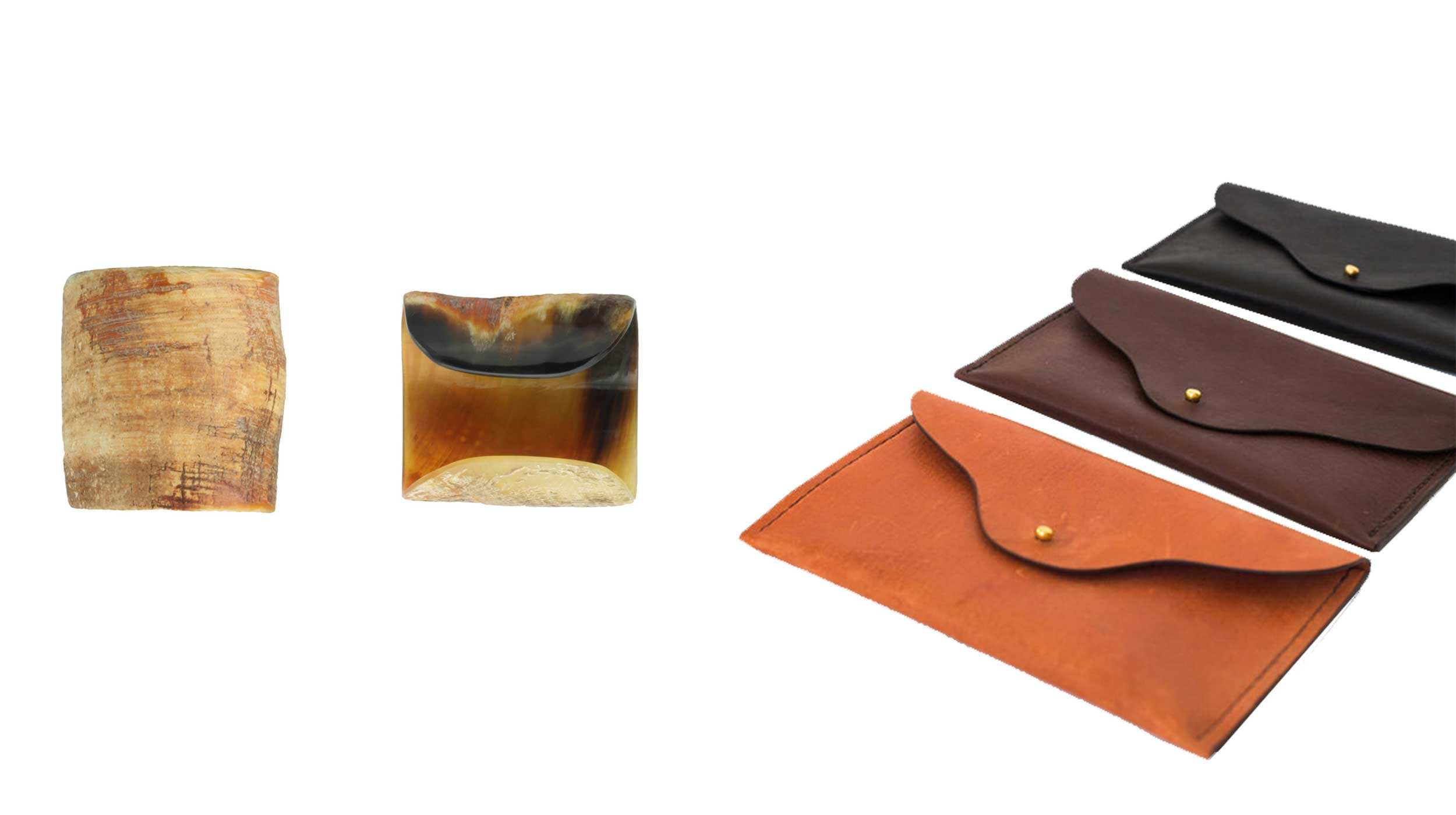 A couple of horn cuffs and a trio of different coloured clutch bags