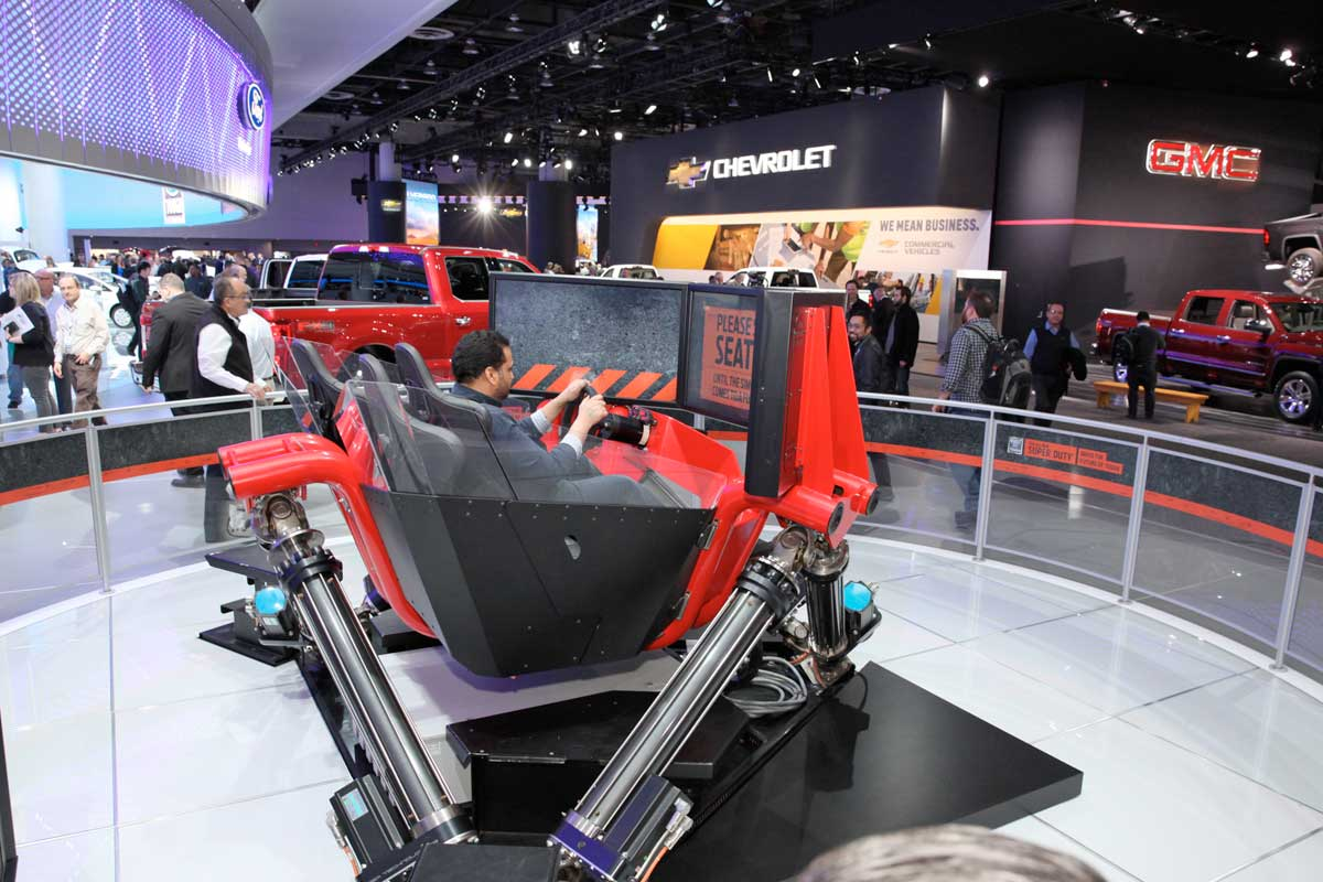 A man in a simulator at the North american International Car Show