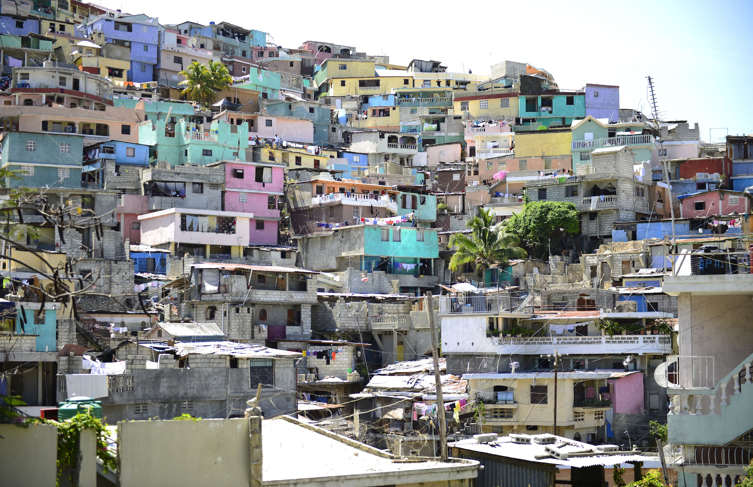 Multi-coloured houses jammed together up a hillside in Port-au-Prince, Haiti