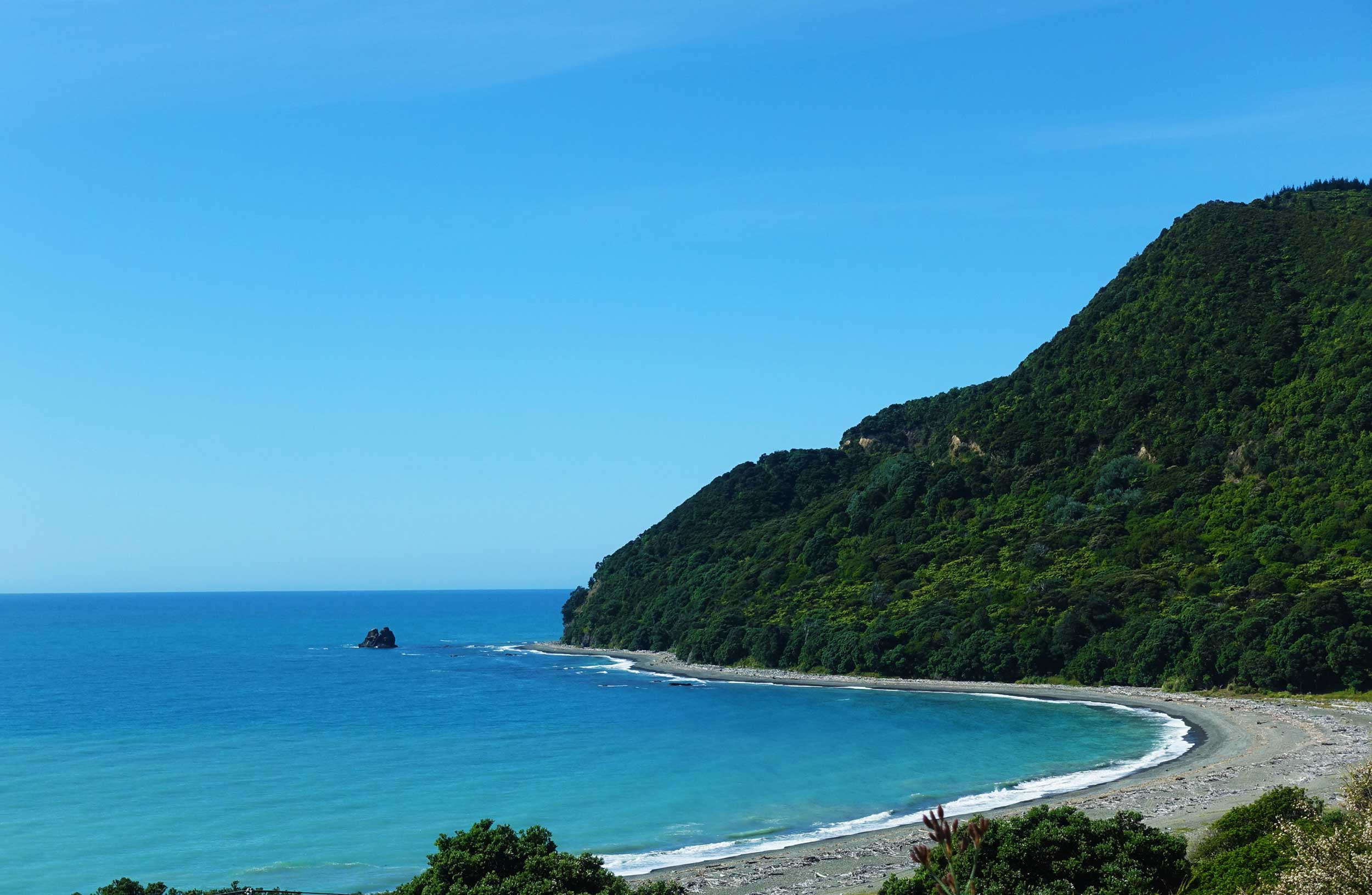 A view of a bay with a sandy beach at East Cape, New Zealand