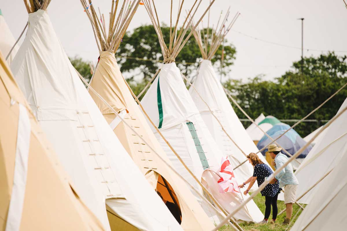 Line of tepee tents at the Isle of Wight festival, UK