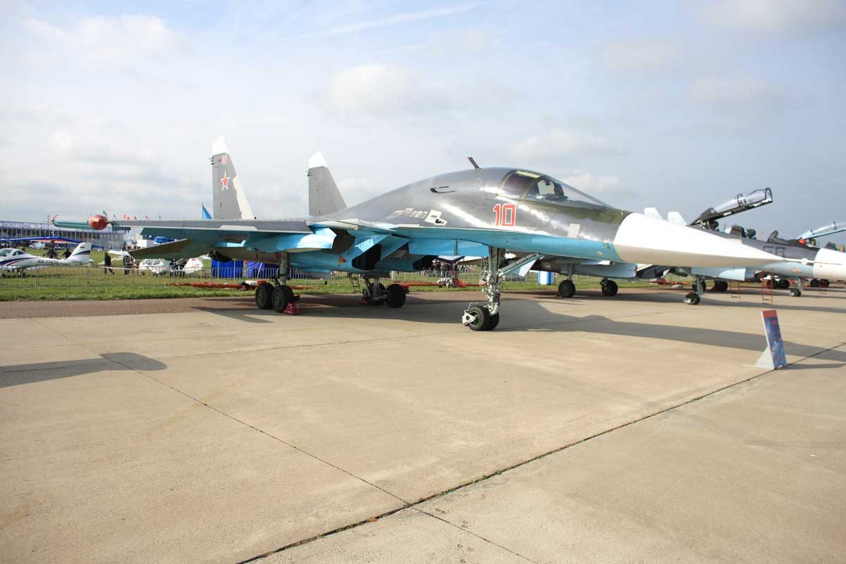 A blue and silver fighter aircraft on the tarmac at MAKS, Zukhovsky