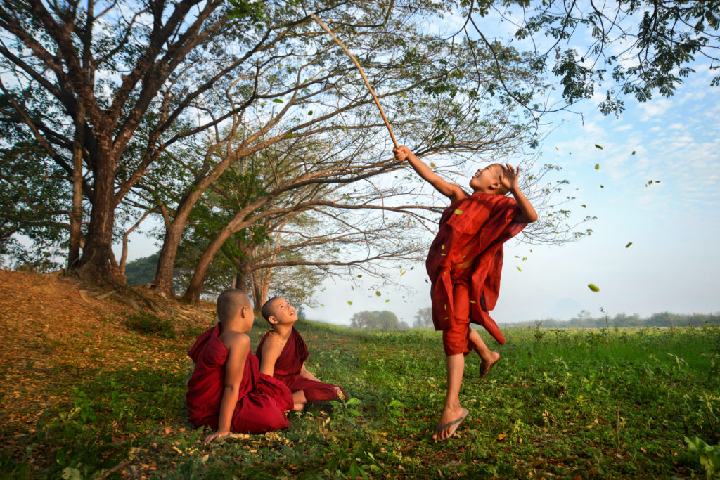 Novice monks playing near their monastery in Hpa-An.