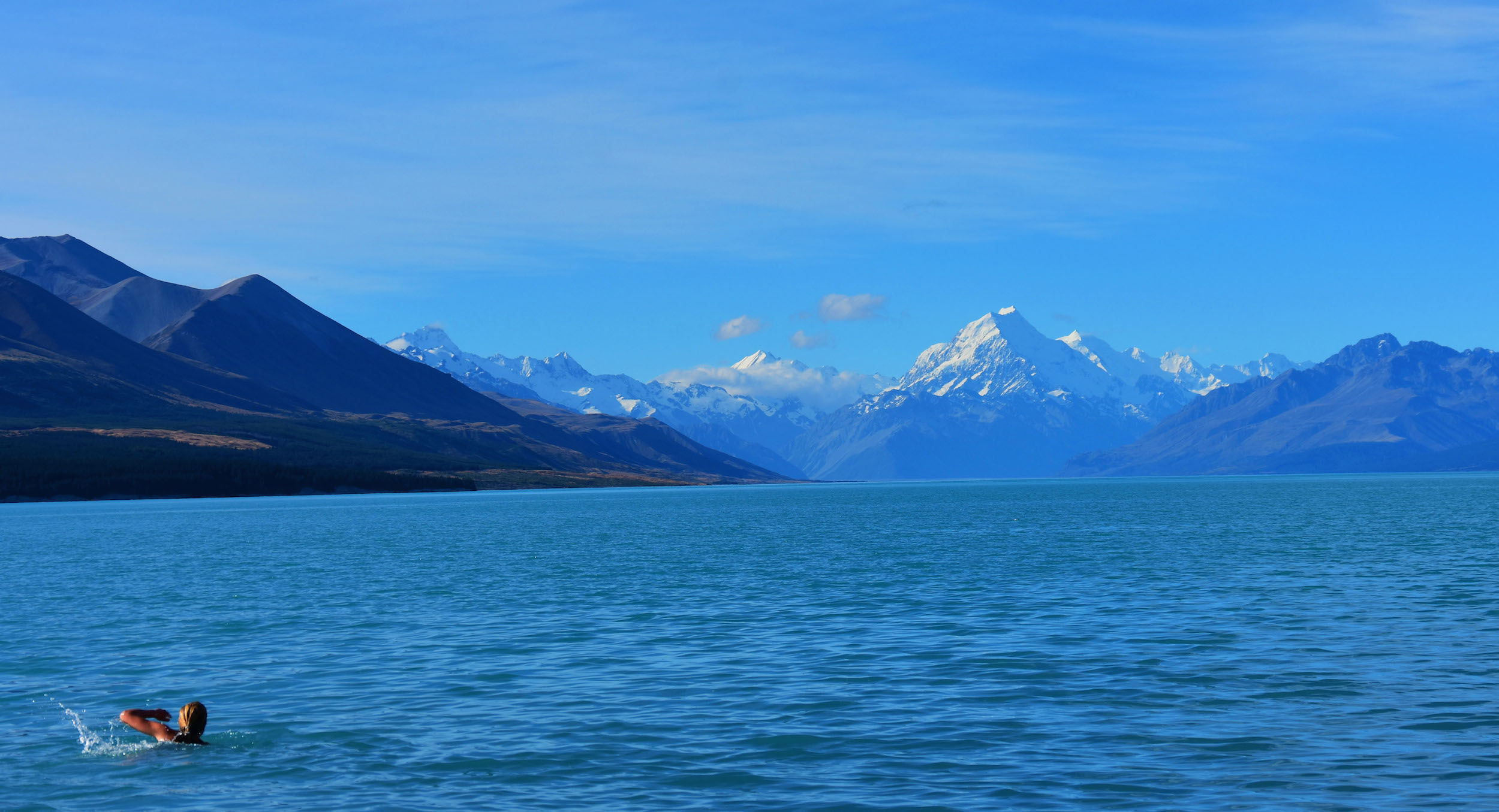 The twin vistas of Lake Pukaki and Mount Cook, which shows a light dusting of late summer snow.