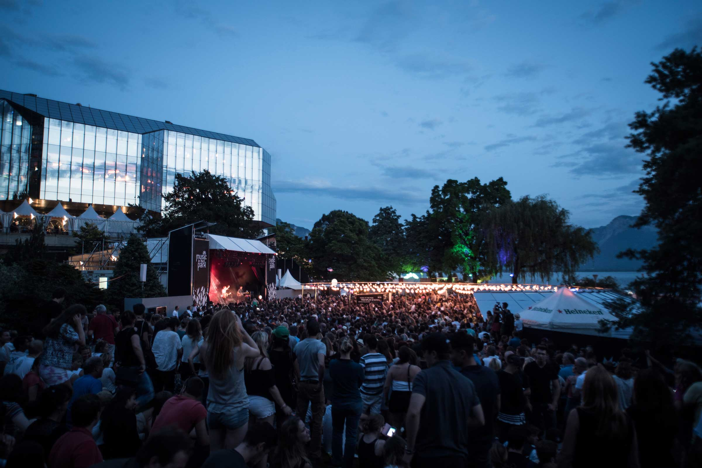 The stage with performers and and the large crowd at Music in the Park , Montreaux Jazz Festival