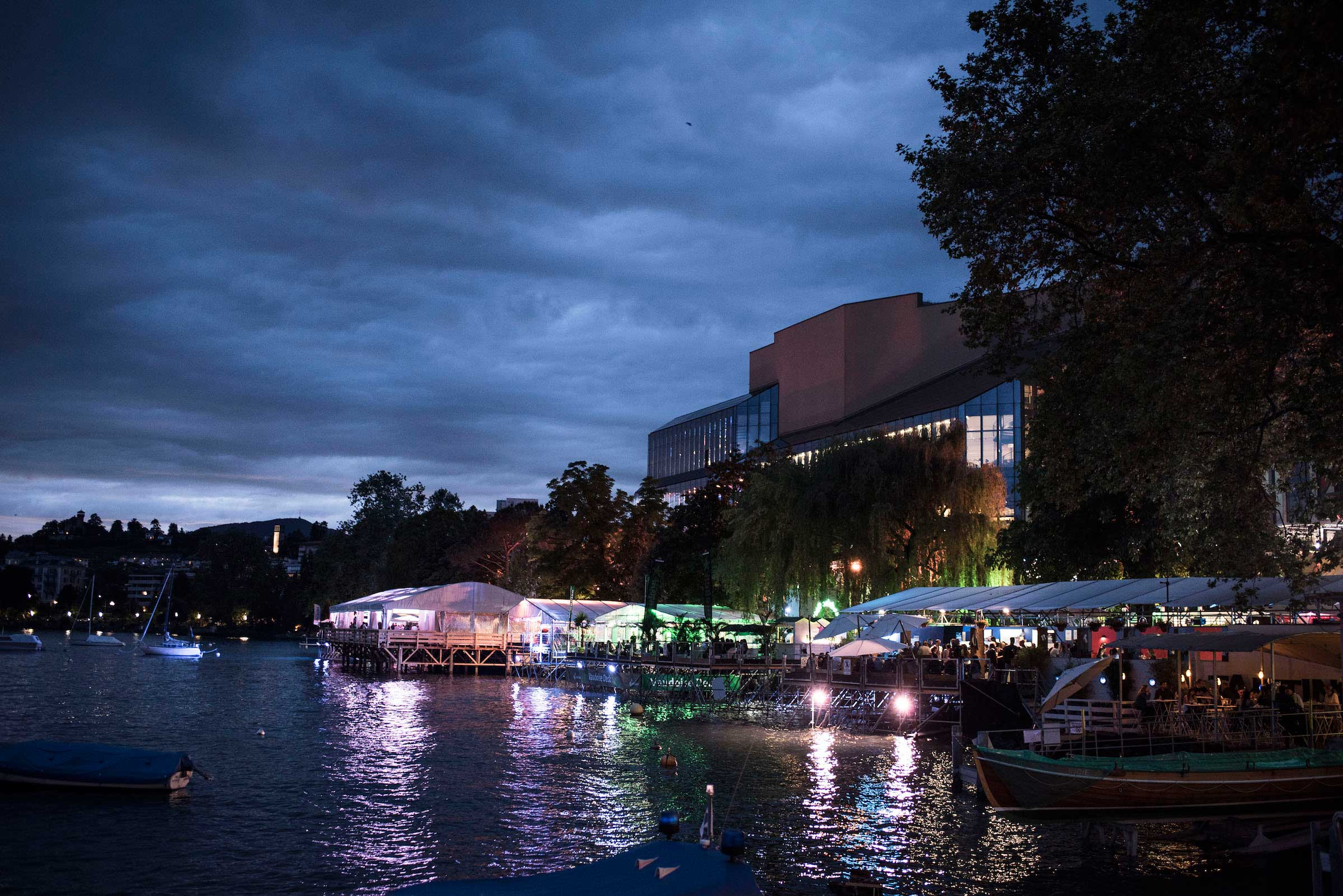 The lighted up promenade from the water at night, Lake Geneve