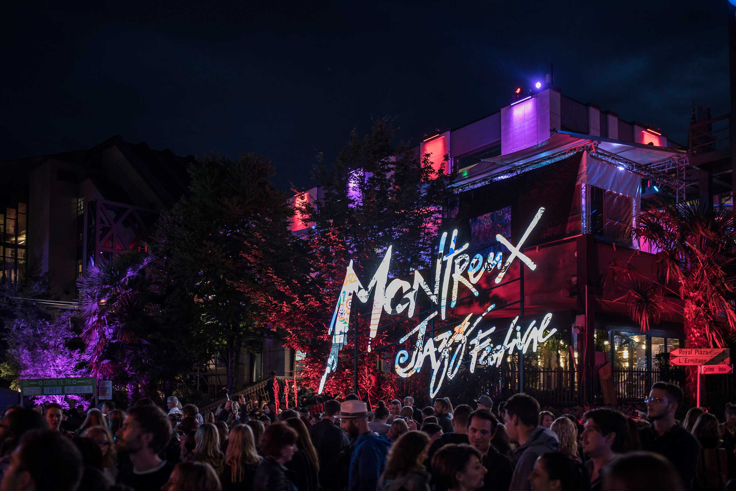 Crowds in the streets and before a huge Montreaux Jazz Festival lighted up sign