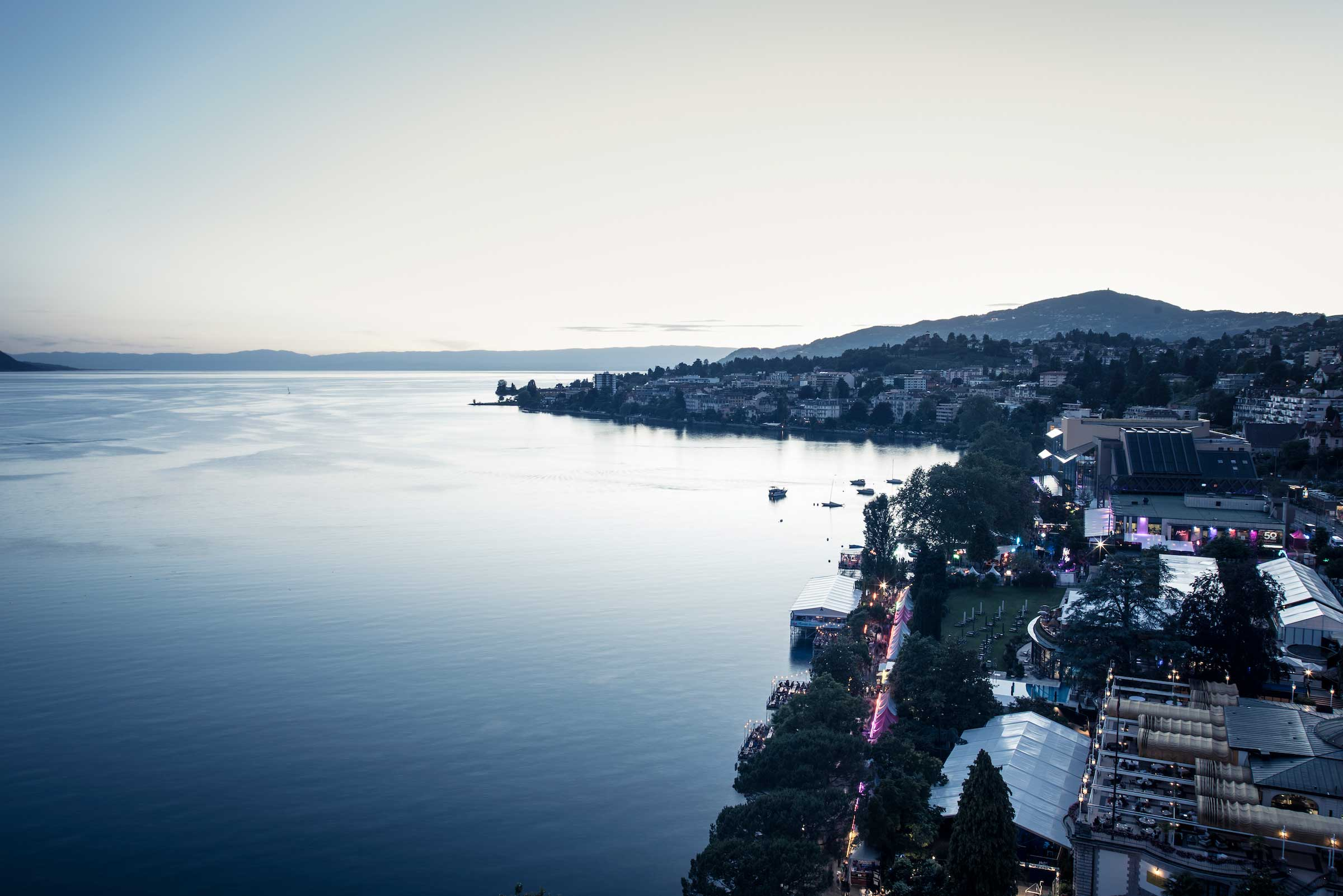 Aerial view of the promenade at dusk and a calm Lake Geneve