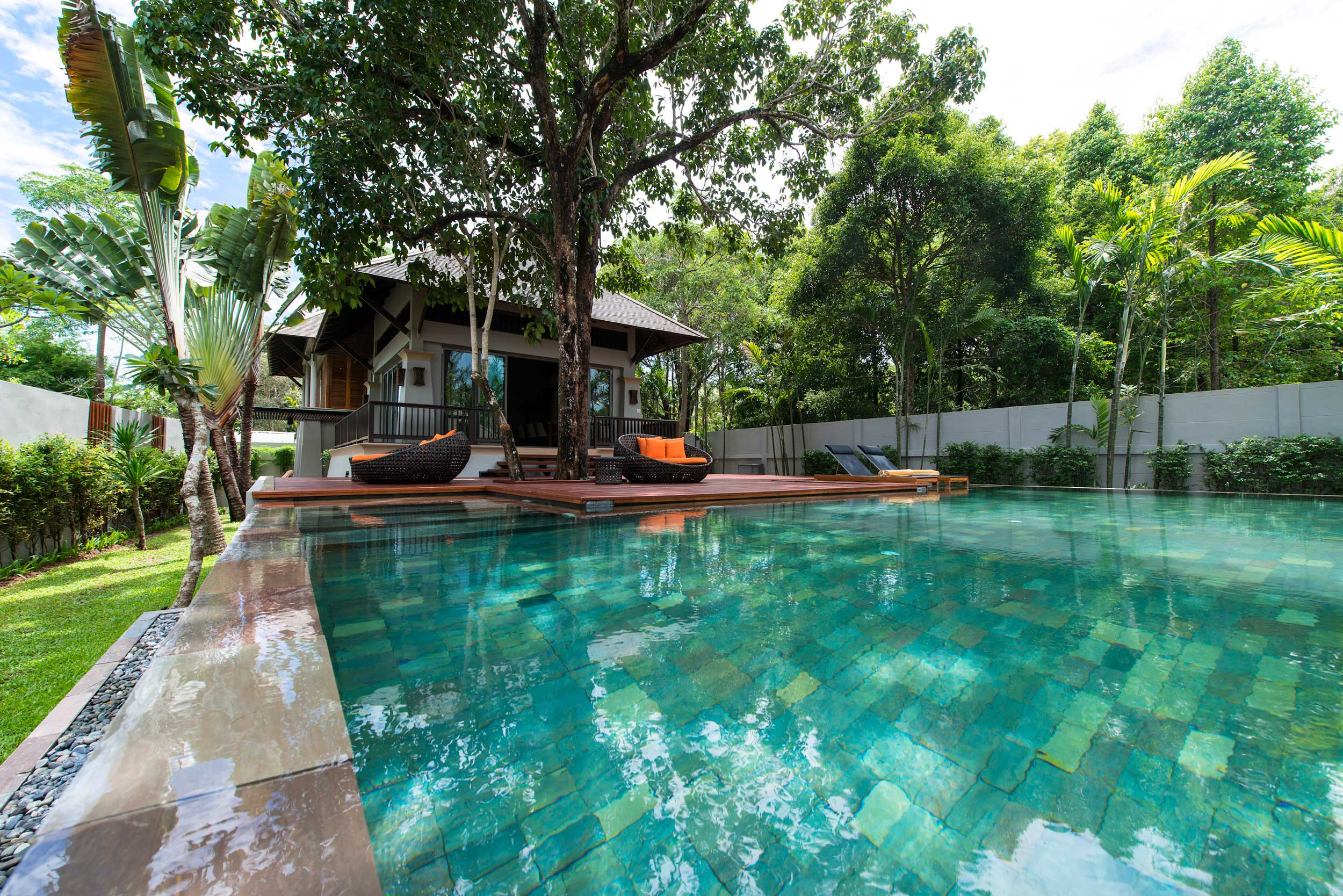 A villa with couch loungers and aaquamarine pool in front of it at Layana Hotel, Thailand