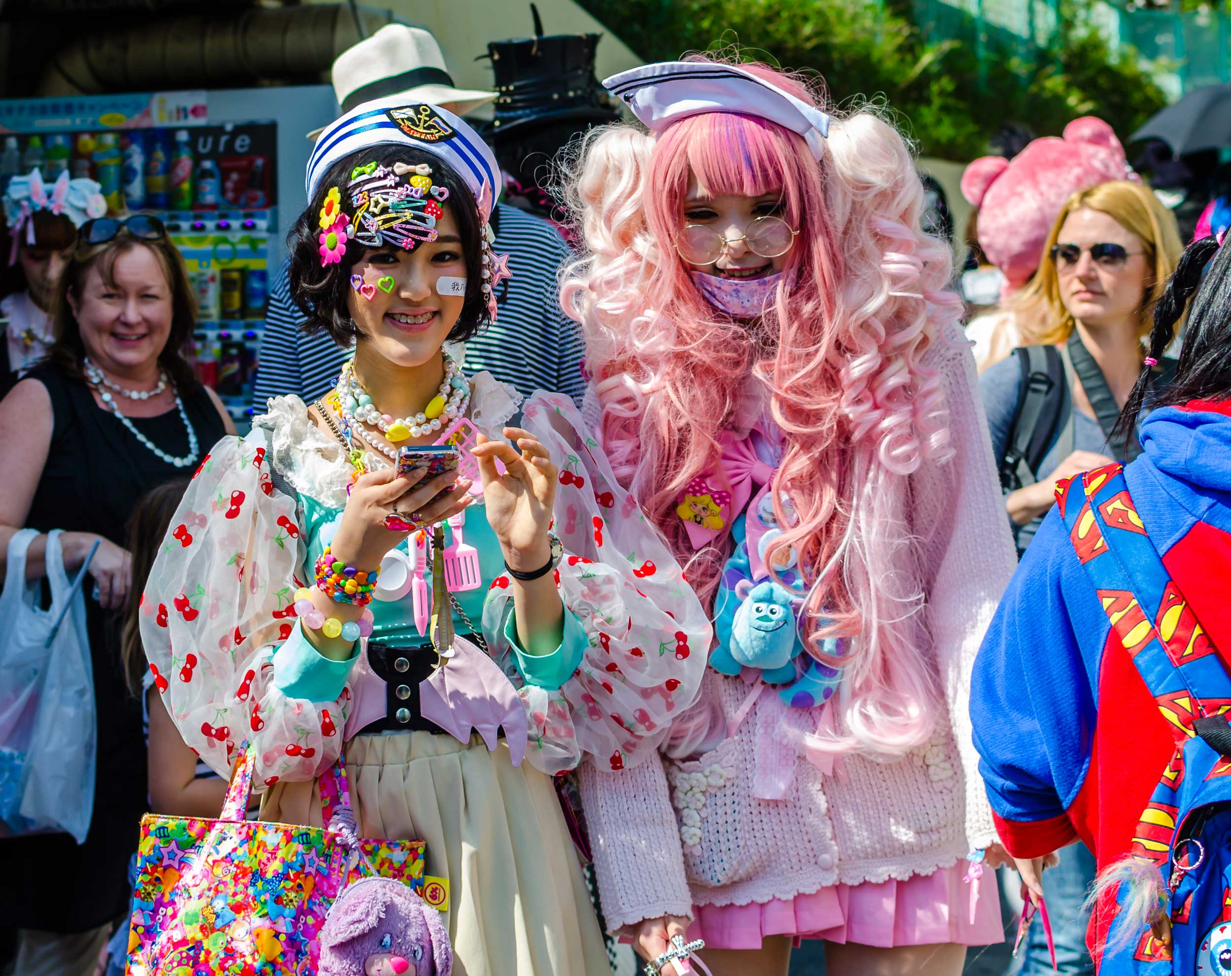 Two women dressed in cosplay outfits in a street in Tokyo
