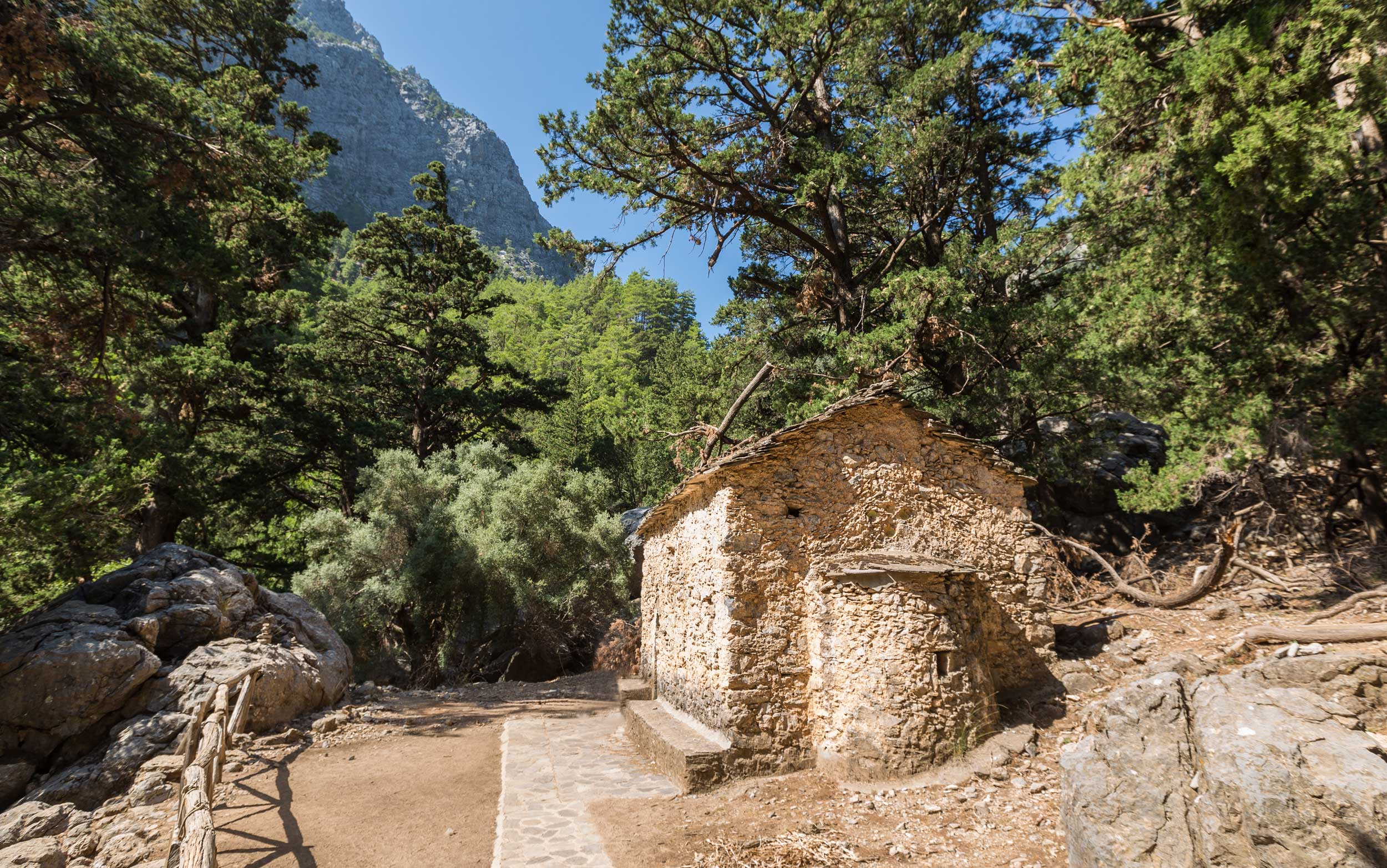Brown rough stone building in the forest of the Samaria gorge, Crete