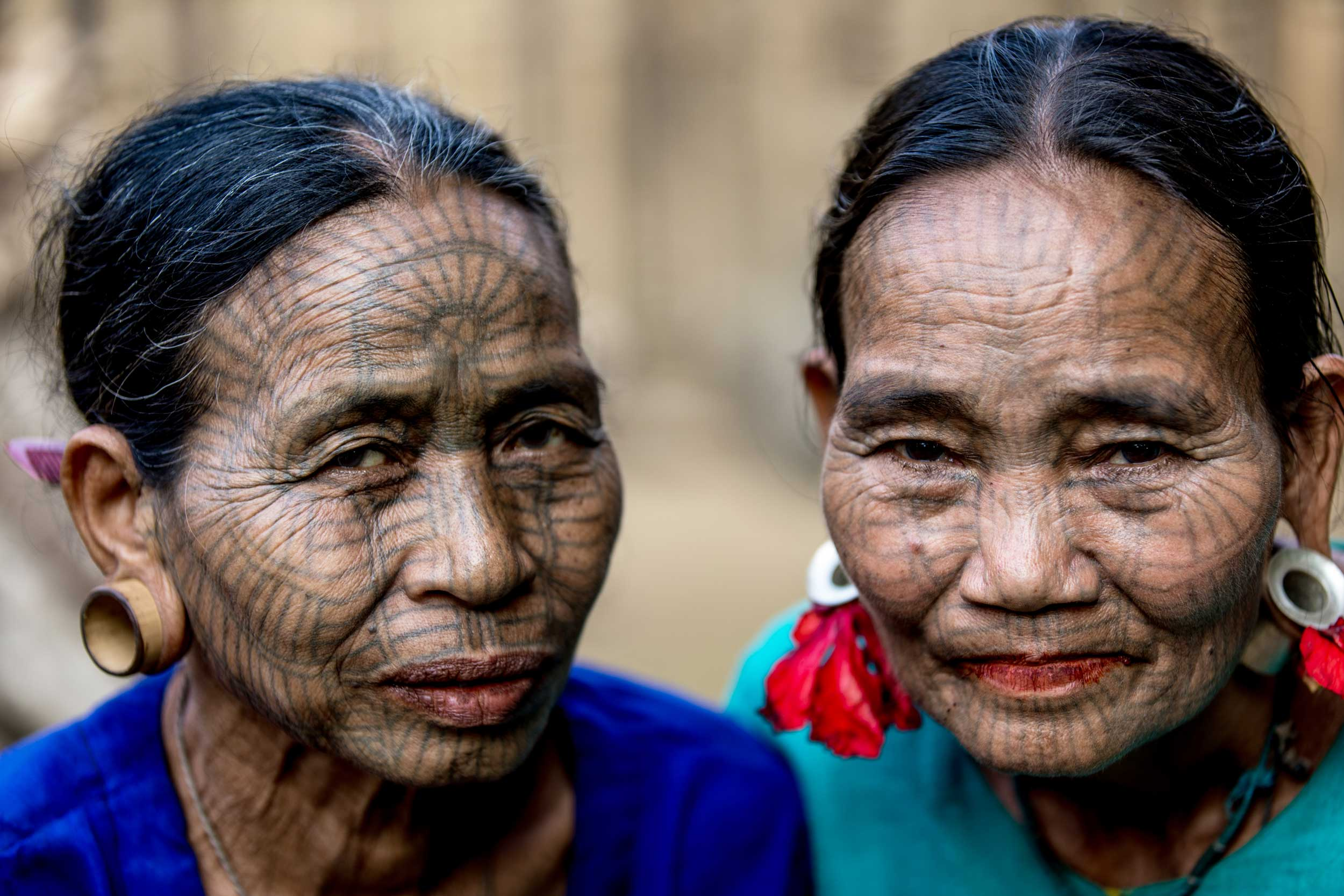 Close-up of two women's tatooed faces, Myanmar