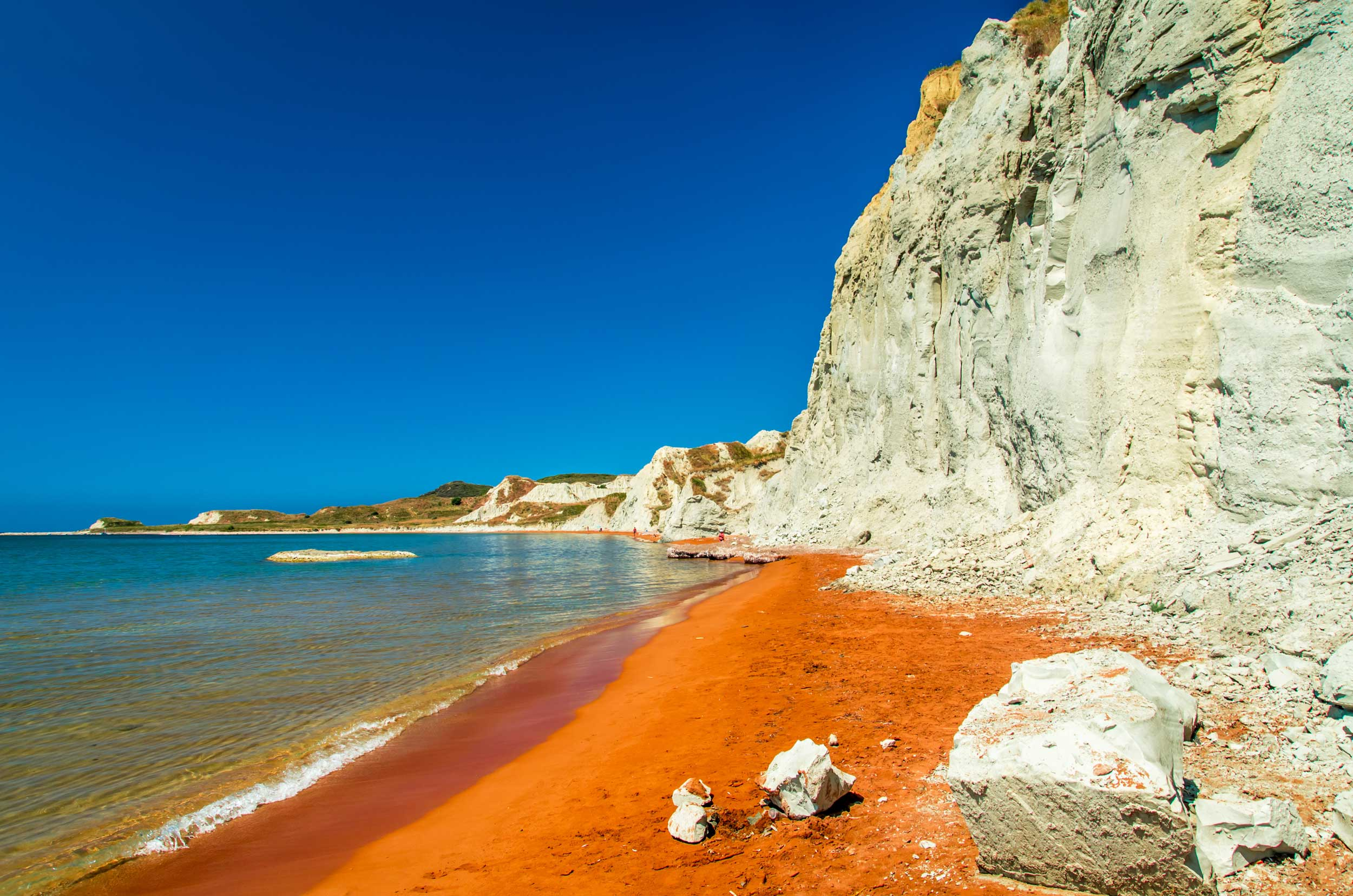 Red sand and grey-white cliffs by the sea, Greece
