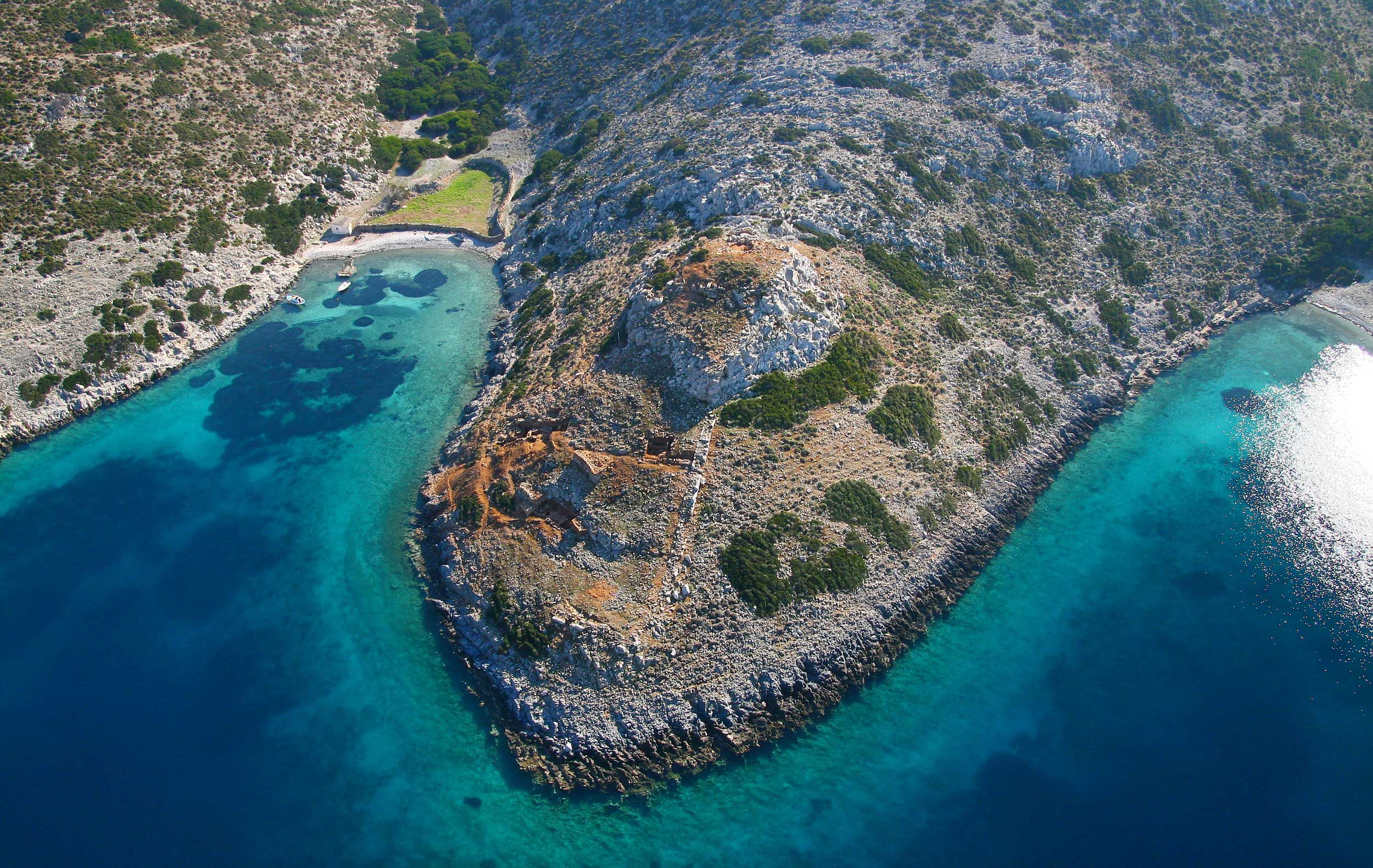 Aerial view of a rocky promontory in an aquamarine sea, Greece