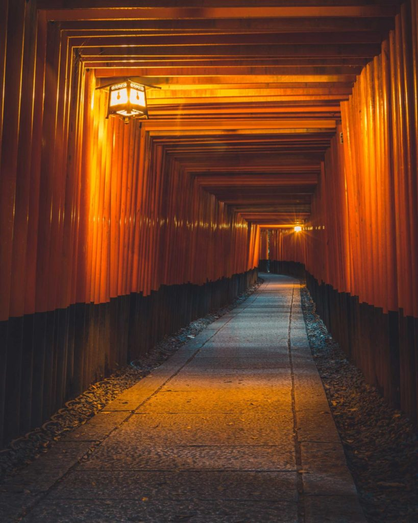 The ten thousand torii gates (Senbon Torii) of Fushimi Inari Taisha in southern Kyoto, line the main path leading to the summit of Mt. Inari. At twilight, the lamps are turned on to create that magical, mystical atmosphere, and if one stays around long enough, one could catch a glimpse of a shinto priest carrying out his last duties of the day.