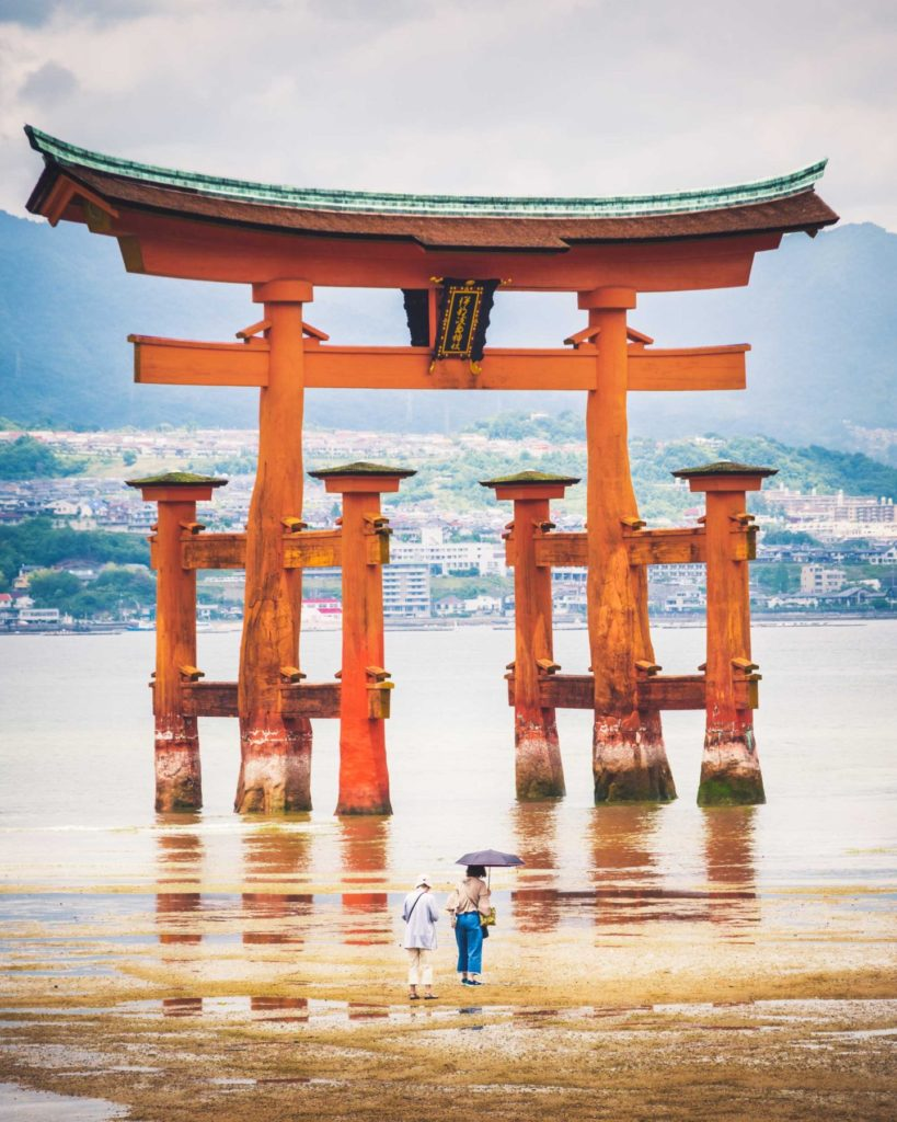 The huge torii gate is the characteristic symbol of Itsukushima shrine on Miyajima island, off the coast of Hiroshima. When the tide is in, the gate appears to be floating on the water and is commonly referred to as the 'floating torii gate'.
