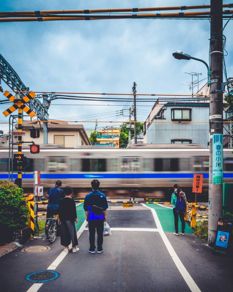 Walking around Tokyo, there are numerous train crossings with trains approaching every 10 minutes. The characteristic bell sound as the train approaches can be heard from some distance as the barriers lower down.