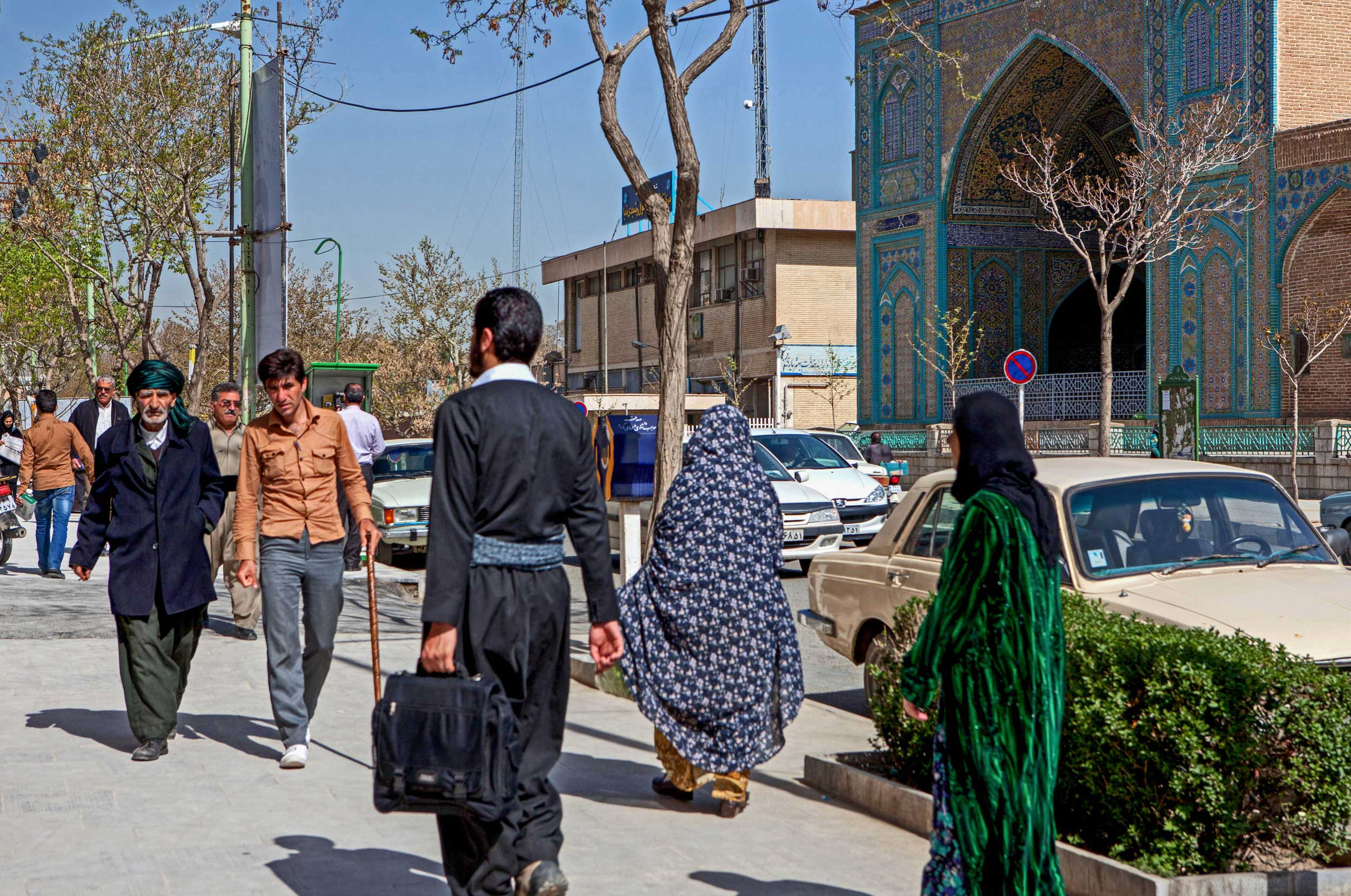 Street scene of brightly dressed kurdish women and men in traditional clthing, Sanandaj, Iran