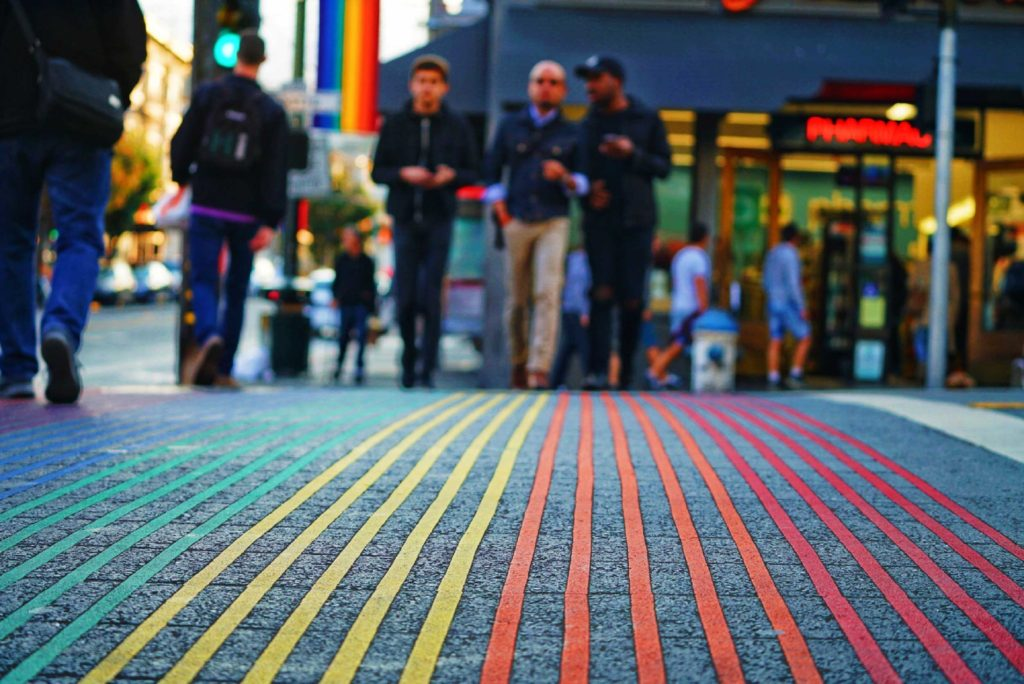 The rainbow crosswalk epitomises the vibrant spirit and LGBT pride of the Castro district of San Francisco.
