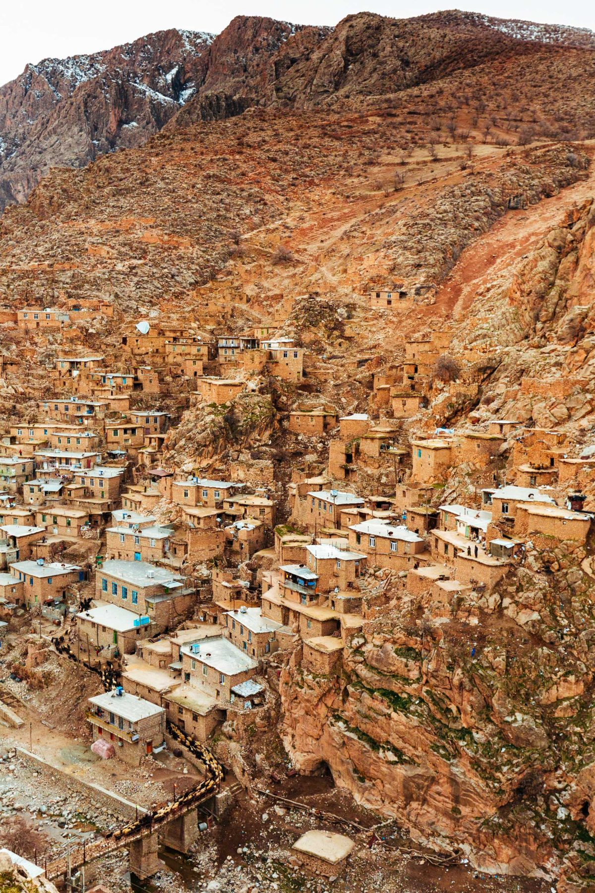 Ancient houses of stone and brick built onto a hillside on Iran