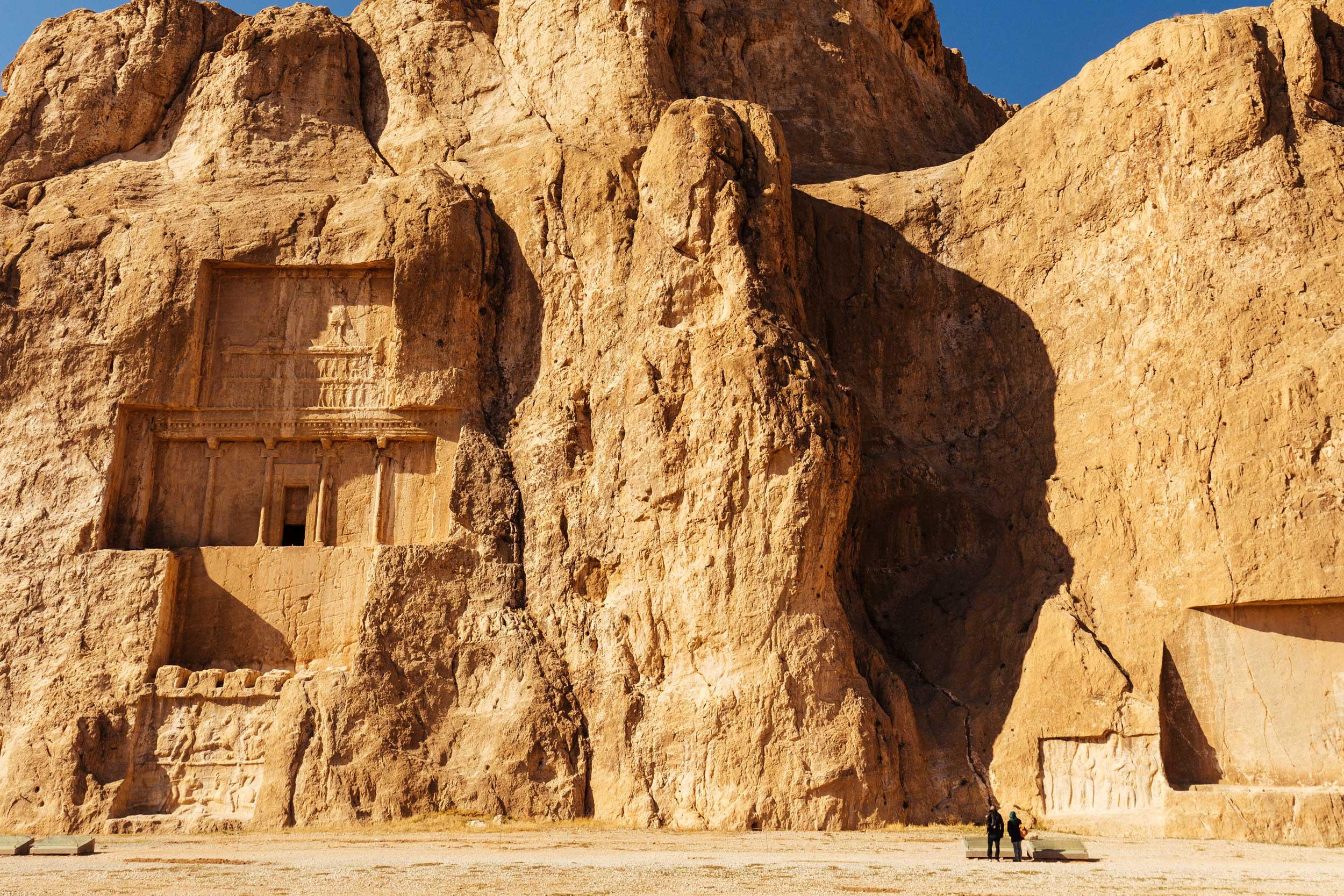 Building carved into a rock hillside in Iran near Shiraz