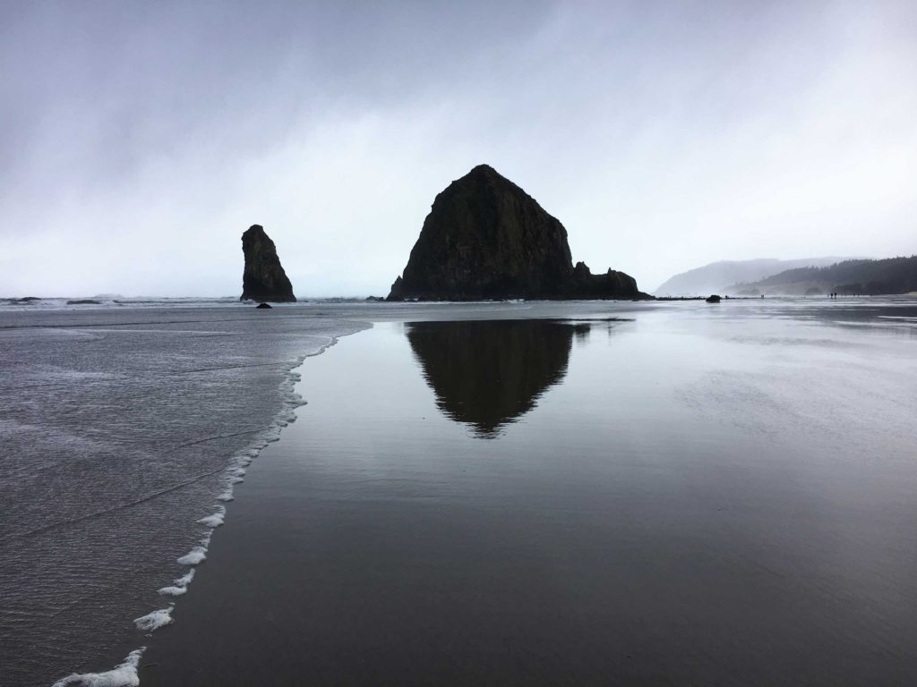 Haystack Rock on Cannon Beach, Oregon: in summer, it is green and filled with life; in winter, it is barren and beautiful, as captured here.