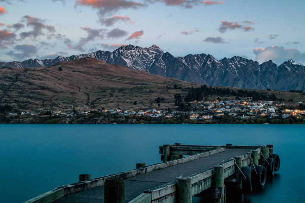 Residents of Queenstown turn on their lights as darkness falls on the town and its beauty, central Otago.